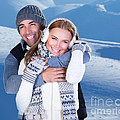 Happy couple playing outdoor at winter mountains Poster by Anna Omelchenko