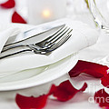 Romantic dinner setting with rose petals Poster by Elena Elisseeva