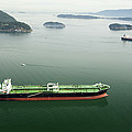 Tanker Ships At Anchor Offshore Of The Print by Andrew Buchanan/SLP