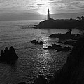 The Sun Is Setting Behind The Pigeon Point Light Station Near Ano Nuevo Print by Scott Lenhart