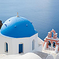 Iconic blue domed churches in Oia Santorini Greece Poster by Matteo Colombo
