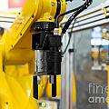 Robot arm in a factory Poster by Oliver Sved