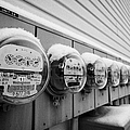 snow covered electricity meters in Saskatoon Saskatchewan Canada Print by Joe Fox