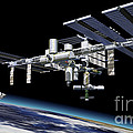 Space Station In Orbit Around Earth Print by Leonello Calvetti