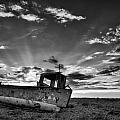 Stunning black and white image of abandoned boat on shingle beac Poster by Matthew Gibson