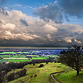 A storm over English countryside with dramatic cloud formations  Poster by Matthew Gibson