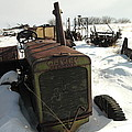 A TRACTOR IN THE SNOW Poster by Jeff  Swan