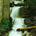 A WATERFALL IN SPRING THAW Print by Jeff  Swan