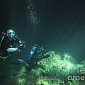 A Young Married Couple Scuba Diving Print by Michael Wood