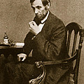 Abraham Lincoln Sitting at Desk Print by Mathew Brady