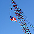 American Flag on Construction Crane Print by Olivier Le Queinec