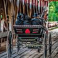 Amish Family on Covered Bridge Print by Gene Sherrill