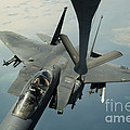 An F-15e Strike Eagle Receives Fuel Print by Stocktrek Images