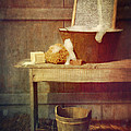 Antique wash tub with soaps Print by Sandra Cunningham