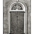 Arched Door in French Quarter in Black and White Poster by Brenda Bryant