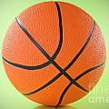 basketball ball over a green background Poster by G J