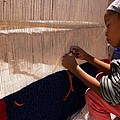 BERBER GIRL WORKING ON TRADITIONAL BERBER RUG AIT BENHADDOU SOUTHERN MOROCCO Poster by ArtPhoto-Ralph A  Ledergerber-Photography