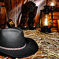 Black Cowboy Hat in an Old Barn Poster by Olivier Le Queinec