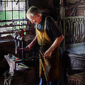 Blacksmith - Starting with a bang  Poster by Mike Savad