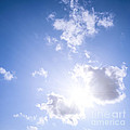 Blue sky with sun and clouds Print by Elena Elisseeva