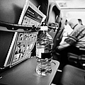 bottle of water on tray table interior of jet2 aircraft passenger cabin in flight europe Poster by Joe Fox