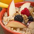 Bowl of steel cut oats served with fresh fruit and honey Print by David Smith