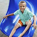 Boy on Slide Poster by Kicka Witte