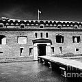 bridge across the moat sally port entrance to fort jefferson dry tortugas national park florida keys Print by Joe Fox