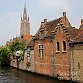 Bruges Houses with Bell Tower Print by Carol Groenen