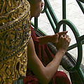 BUDDHIST MONK LEANING AGAINST A PILLAR SULE PAGODA CENTRAL YANGON MYANAR Print by ArtPhoto-Ralph A  Ledergerber-Photography