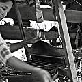 Burmese woman working with a handloom weaving. Print by RicardMN Photography