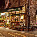 Cafe in Assisi at Night Print by Susan  Schmitz