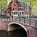 Canal Bridge and Houses in Amsterdam Print by Artur Bogacki