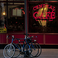 Central Cafe Bicycles Print by Susan Candelario