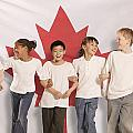Children In Front Of Canadian Flag Poster by Don Hammond
