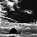Clouds over Haystack Rock on Cannon Beach Poster by David Patterson