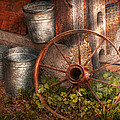 Country - Some dented pails and an old wheel  Print by Mike Savad