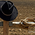 Cowboy Hat and Rope on Fence Print by Olivier Le Queinec