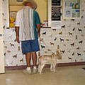 Dog owner dog vet's office Casa Grande Arizona 2004 Poster by David Lee Guss