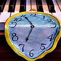 Dripping clock on piano keys Print by Garry Gay