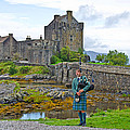 Eilean Donan Castle and the Lone Piper Poster by Chris Thaxter