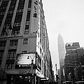 empire state building shrouded in mist as pedestrians crossing crosswalk on 7th ave new york Print by Joe Fox