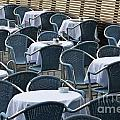 Empty restaurant seats and tables Print by Sami Sarkis