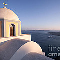 Famous orthodox church in Santorini Greece at sunset Poster by Matteo Colombo