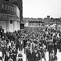 Fans leaving Yankee Stadium. Print by Underwood Archives
