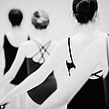 female teenage ballet students holding on to a ballet barre at a ballet school in the uk Print by Joe Fox
