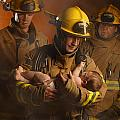 Fire Fighters Rescuing A Baby Print by Don Hammond