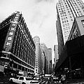 fisheye shot of yellow cab on intersection of broadway and 35th street at herald square new york Print by Joe Fox