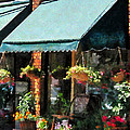 Flower Shop With Green Awnings Poster by Susan Savad