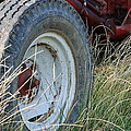 Ford Tractor Tire Print by Jennifer Lyon